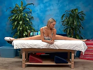 Fantastic blonde stretching before a massage