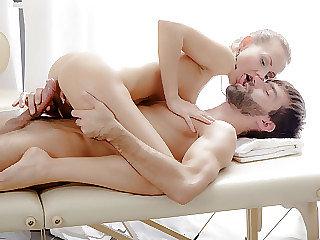 Julie hoists one gam to let massagist get a better view of her twat
